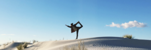 image of person doing yoga pose on sandy landscape